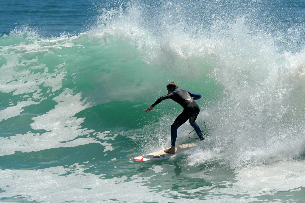 . A surfer rides a wave at Surfrider Beach in Malibu, Wednesday, August 27, 2014. (Photo by Michael Owen Baker/Los Angeles Daily News)