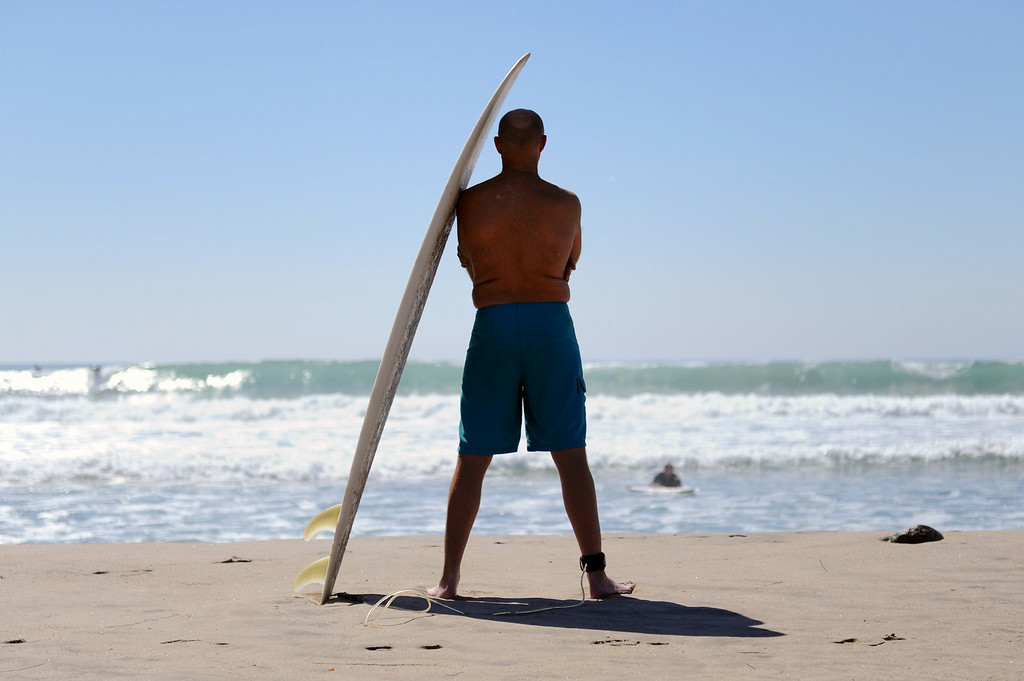 . Mike Spadone watches his son after surfing at Surfrider Beach in Malibu, Wednesday, August 27, 2014. (Photo by Michael Owen Baker/Los Angeles Daily News)