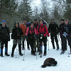 Today's hikers. Emma licks Musher's Wax off her paws.<br /> February 13, 2010