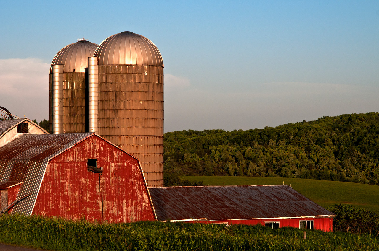 June 1 - A local barn being painted a beautiful hue from the setting sun.