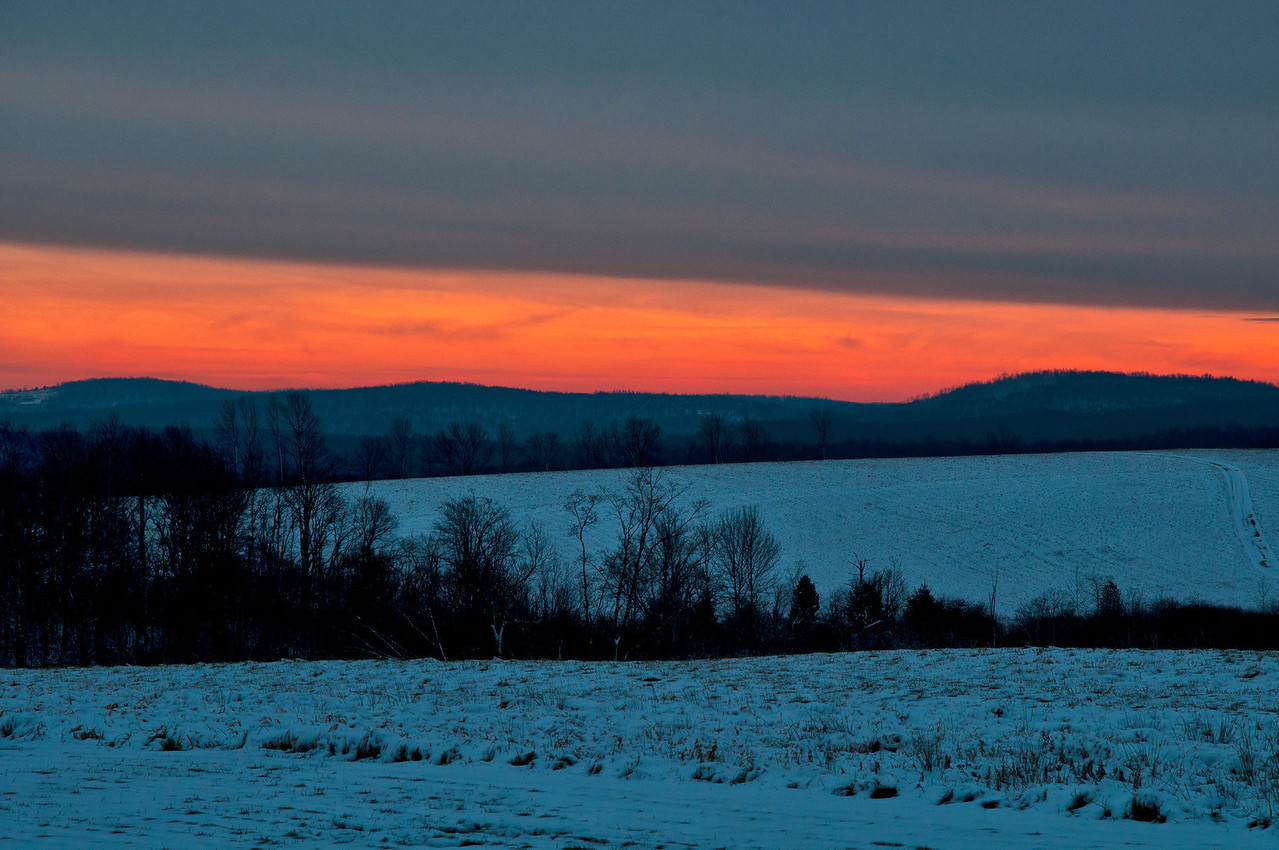 December 9 - Wanted a touch of color into today's shot.  The hills of Columbus.  My place is below the second tree line.