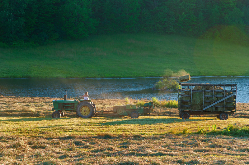 July 12 - Drove around catching the beautiful late day light making photographs mostly of various barns in the area.  Headed home and on my road I fell across this scene.  Haying in motion.  Moments can be so fleeting!