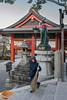 Kitsune statue with rice stalk