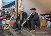 Taking a break with a bong and a cigarette at the Shengcun Market, Yunnan Province, China.<br /> <br /> I got out my D7100 camera a couple of days ago after not using it for a long time and discovered a number of images from China and Brazil were on the card that I had never downloaded.  Good thing I didn't erase the card without checking!  This is one of the shots.