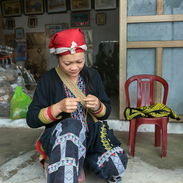 Red Dao woman at work on her embroidery