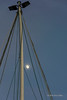 Ship's mast with gibbous moon