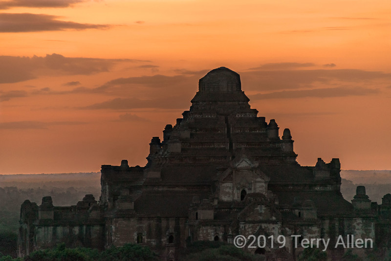 Dhammayangyi Temple at sunrise, Bagan, Myanmar<br /> <br /> This is most massive temple in Bagan, with the best brick work. It was built by King Narathu (1167-70), who, by all accounts, was pretty psycotic. According to legend, Narathu oversaw the construction of the temple himself. The bricks were laid without mortar, and the masons were executed if a needle could be pushed between the bricks they had laid. Narathu never completed the construction because he was assassinated before its completion, so there is no top section to the temple