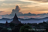 Sunset view from Shwesandaw Pagoda towards the Irrawaddy River, Bagan, Mayanmar<br /> <br /> The clouds mimic the shape of the hills, which in turn mimic the shapes of the stupas.  The river is in the smoke-filled depression before the start of the hills, and is barely apparent as a couple of bright spots in the image at the base of the hills (best seen at larger sizes).<br /> <br /> Paul Bellinger asked about how it was to travel in Myanmar.  No problems, whatsoever.  The people were wonderful, we encountered little or no bureaucracy, the accommodations were excellent and the food was great.  We had arranged a private tour for just the 5 of us, and had an English-speaking guide and a driver at each location.  This was not expensive at all and the guide knew where to take us for good photography.  The local artisans were incredible, using historical techniques to create their masterpieces; these techniques have all but disappeared from Westernized cultures.  Some pics of this will follow, but I am still pretty far behind on my editing, and am about to disappear on another adventure.