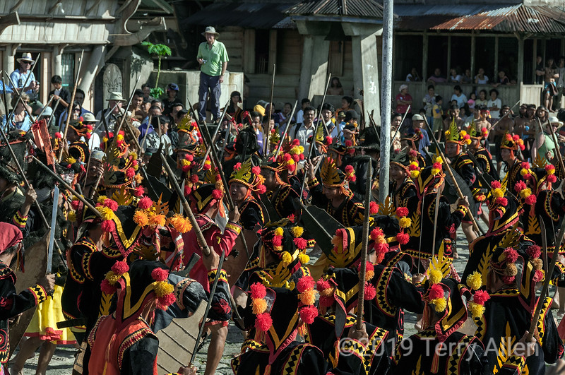 """War dance in the village square, Bawomatuluo Village, Nias Island, Sumatra<br /> <br /> Not easy to photograph this psychedelic chaos, with the warriors producing a riot of colour and activity!  Some portraits of individual warriors can be found here <a href=""""http://goo.gl/JdqYc"""">http://goo.gl/JdqYc</a><br /> <br /> Again there were many excellent photos posted yesterday.  It is getting difficult to keep up with making comments when everyone is outdoing themselves these days!  There are many great photos in the later pages that now go uncommented on. Too bad, since I'm sure those photographers would appreciate some encouragement, as well. I will try to make more of an effort to seek out some of those photographs and encouage others to do the same."""