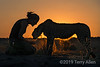 Best friends <br /> <br /> Marlice and her cheetah at sunset, Na'ankuse, Namibia. Cheetah are the most 'tameable' of the big cats when raised from a very young age, as this one was, but they are still wild animals.  Marlice and her colleagues at the Na'ankuse Foundation have the skills and the proper facilities to take good care of the cheetahs and to rehabilitate them for release into the wild. (They have the loudest, most fantastic purr I have ever heard!!)