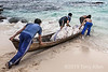 """Copra workers launching a loaded dugout canoe through the surf, Simeulu Island, Sumatra<br /> <br /> This photo gives a feeling for the weight of the dugout canoe, especially when loaded with the copra sacs for transport out to the larger ship off shore (seen here <a href=""""http://goo.gl/DoVl6"""">http://goo.gl/DoVl6</a> and here <a href=""""http://goo.gl/Z6Tn3"""">http://goo.gl/Z6Tn3</a>).  I always try to interact with my photo subjects, in this case by trying to heft one of the copra sacs into the canoe for them (much to the amusement of the workers) and they are HEAVY!"""