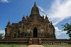 """Temple 2, Bagan, Myanmar<br /> <br /> The Buddha image that is barely visible through the doorway (especially at the larger sizes) can be seen here <a href=""""http://goo.gl/q9anG"""">http://goo.gl/q9anG</a>.<br /> <br /> The fantastic temple complex of Bagan rivals Angor Wat for its number of temples, but is not as well known since Myanmar was closed to tourism for so long. Bagan is on the plains of the Irrawaddy River west of Mandalay.  Between the 11th and 13th century over 10,000 temples and stupas were built there, of which around 2000 remain.  Roughly speaking, a stupa is a solid structure that can't be entered and a temple has an interior that contains images, usually statues of Buddhas."""
