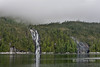 """Waterfalls emerging from the mist<br /> <br /> In the spring the high snowfields in the Cascade Mountains of the Great Bear Rainforest start to melt and the water cascades down the walls of the fjords into the sea.<br /> <br /> 4/10/13  <a href=""""http://www.allenfotowild.com"""">http://www.allenfotowild.com</a>"""