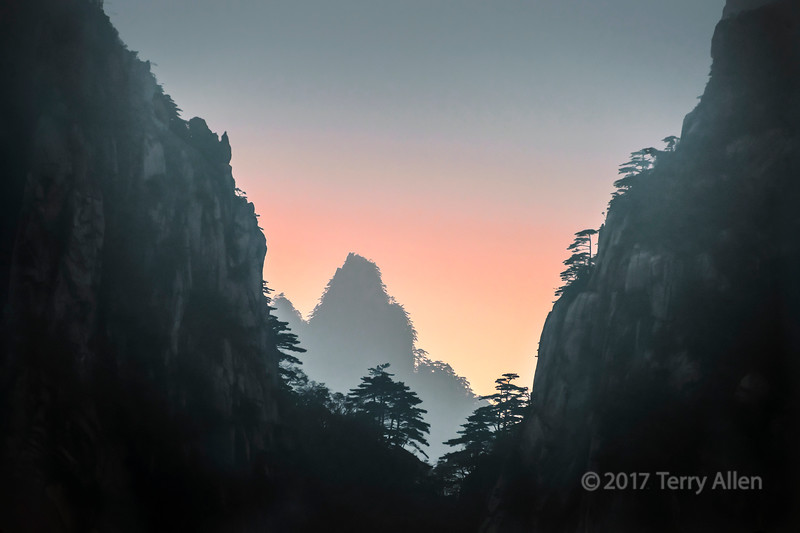 Sunset and misty mountains