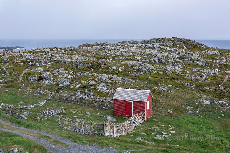 Rocky shore and red shed