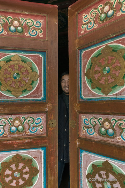 """Welcoming smile (best larger)<br /> <br /> Manzushir Monastery, Bogd Khan Mountains, Mongolia<br /> <br /> This relatively new small monastery building had beautiful doors. The original temple, Togchin, was destroyed during the Communist years in the early 1930s.  As I was photographing the doors, I noticed there was a man behind them, creating a nice photo op.<br /> <br /> Other photos from the local area, including the temple ruins, can be seen here: <a href=""""http://goo.gl/J0fhHV"""">http://goo.gl/J0fhHV</a><br /> <br /> 11/01/15  <a href=""""http://www.allenfotowild.com"""">http://www.allenfotowild.com</a>"""