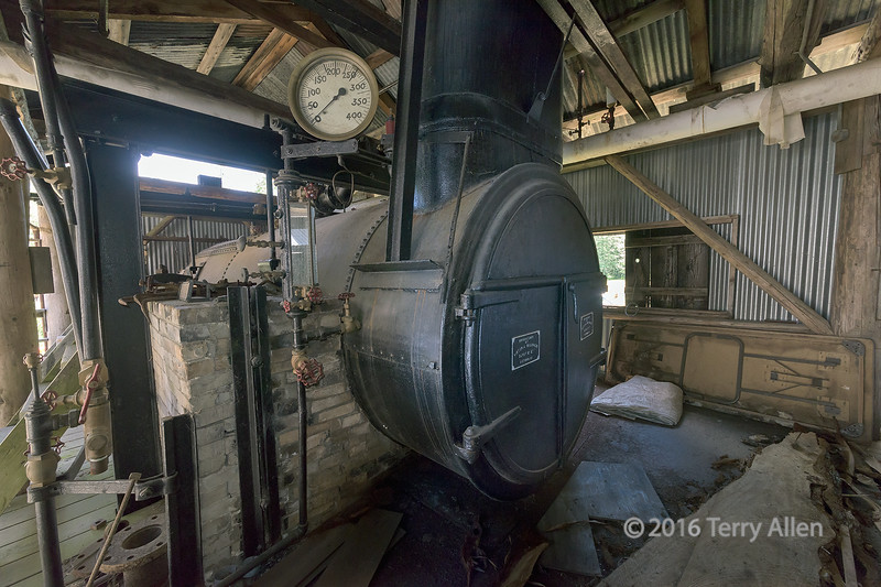 """Steam furnace that runs an old steam-powered sawmill<br /> <br /> McLean Mill, Alberni Valley, British Columbia.  The mill originally ran as a family operated saw-milling business from 1926 to 1965.  It still operates, now at a national historic site.<br /> <br /> Other photos of the old mill can be seen here: <a href=""""http://goo.gl/bNZeSz"""">http://goo.gl/bNZeSz</a><br /> <br /> 10/08015  <a href=""""http://www.allenfotowild.com"""">http://www.allenfotowild.com</a>"""