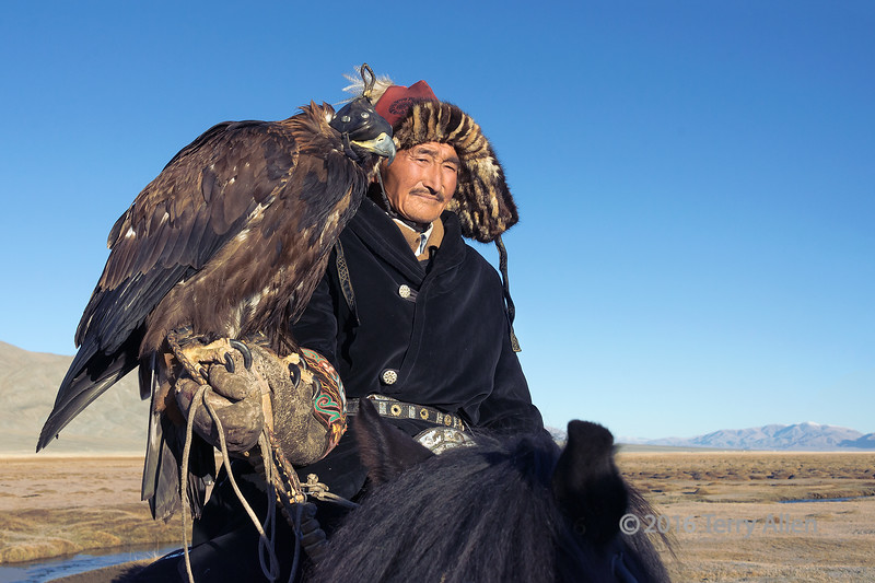 "Kazakh eagle hunter and his golden eagle<br /> <br /> Taken on the steppes of Western Mongolia.  Other photos of this group of eagle hunters can be seen here: <a href=""http://goo.gl/evlBwd"">http://goo.gl/evlBwd</a><br /> <br /> 10/04/15  <a href=""http://www.allenfotowild.com"">http://www.allenfotowild.com</a>"