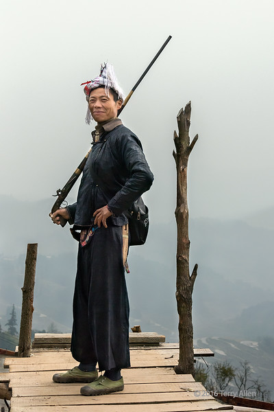 """Portrait of a Basha gunman<br /> <br /> Basha Miao village, Guizhou Province, China.  He is holding a rather uncommon pistol grip flintlock rifle.<br /> <br /> So busy these days, it's hard to keep up with editing and commenting, so only 2 pics today.<br /> <br /> 08/05/15  <a href=""""http://www.allenfotowild.com"""">http://www.allenfotowild.com</a>"""