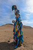 "Shamanic figure<br /> <br /> I learn so much when I travel and take photos.  The things I see prompt me to do a lot of research to understand the significance of what I am photographing.  Stopping at a roadside shrine in Mongolia prompted me to learn more about the fascinating religion of Tengriism. <br /> <br /> This figure is from a religion known as Tengriism,  practised by the people in Central Asia, including Mongolia.  The religion dates from ancient times, and focuses on living in harmony with the natural universe. Tengriism revolves around the sun deity Tengri, and focuses on balance with nature.  Tengriism is believed to have begun sometime around the Bronze Age (3,300 B.C. to 1,200 B.C)., and is one of the world's oldest religions. It incorporates characteristics of shamanism, animism, totemism, both polytheism and monotheism, and ancestor worship. Those who practice Tengriism hold the belief that their very existence is sustained by the spirit of the blue Sky (Tengri), and the fertile Mother Earth (Eje).  The blue scarfs symbolise the sky.<br /> <br /> An ovoo shrine can be been here, along with an explanation of its symbolism and current practices: <a href=""http://goo.gl/pDzkFI"">http://goo.gl/pDzkFI</a><br /> <br /> 14/02/15  <a href=""http://www.allenfotowild.com"">http://www.allenfotowild.com</a>"