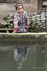 """Little girl reflected in the village pond, Huanggang Dong Vilage, Guizhou Province, China<br /> <br /> Other photos from the village can be seen here: <a href=""""http://goo.gl/imEU2Q"""">http://goo.gl/imEU2Q</a><br /> <br /> 16/07/15  <a href=""""http://www.allenfotowild.com"""">http://www.allenfotowild.com</a>"""