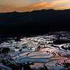 "Sunrise over the rice terraces (best larger)<br /> <br /> Panoramic view of some of the 1300 year old flooded rice terraces in Yuanyang County, China.  The best time of year to photograph them and get the sunrise or sunset reflected in the water is the winter (although it meant living and sleeping in my outdoor clothes since the temperature indoors was the same as outdoors)<br /> <br /> Other photos from the area can be seen here: <a href=""http://goo.gl/dfjnzG"">http://goo.gl/dfjnzG</a><br /> <br /> 30/01/15  <a href=""http://www.allenfotowild.com"">http://www.allenfotowild.com</a>"