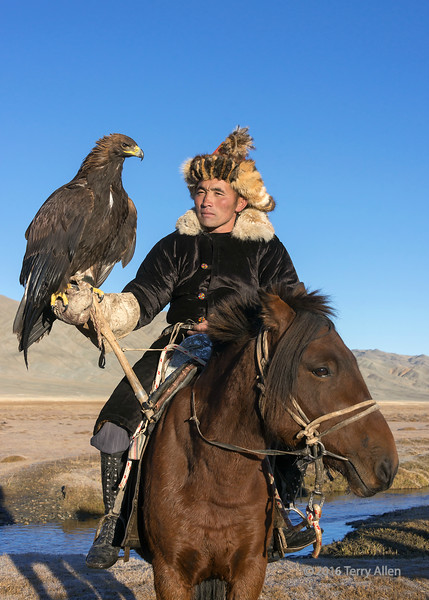 """Portrait of an Kazakh eagle hunter, his eagle and his horse (best larger)<br /> <br /> This is one of my favourite portraits that I captured of the three of them.<br /> <br /> Other photos of eagle hunters, eagle and horses can be seen here: <a href=""""http://goo.gl/n4nnZ9"""">http://goo.gl/n4nnZ9</a><br /> <br /> 05/04/15  <a href=""""http://www.allenfotowild.com"""">http://www.allenfotowild.com</a>"""
