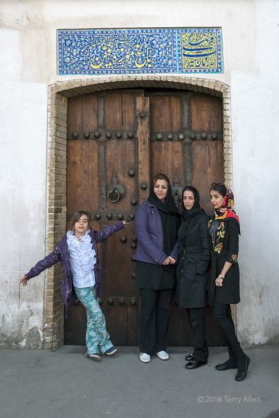 """Three woman and a girl<br /> <br /> Old wooden entry door to Bagh-e-Fin (Fin Garden, 1590), Kashan, Iran, a UNESCO World Heritage site.<br /> <br /> More photos of people in and around the gardens can be seen here: <a href=""""http://goo.gl/W6Le0i"""">http://goo.gl/W6Le0i</a><br /> <br /> 13/05/15  <a href=""""http://www.allenfotowild.com"""">http://www.allenfotowild.com</a>"""