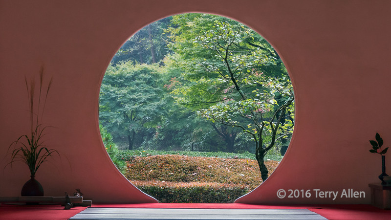 The round window<br /> <br /> For me, this is a quintessentially Japanese scene, with the tatami mat, the flower arrangements (ikebana) and the round window looking onto a beautiful garden.<br /> <br /> Meigetsu-in Rinzai Zen temple, Kamakura, Japan.  Kamakura is not only the site of the giant bronze statue of Buddha (Daibutsu) but also contains many temples and shrines with the most beautiful Japanese gardens
