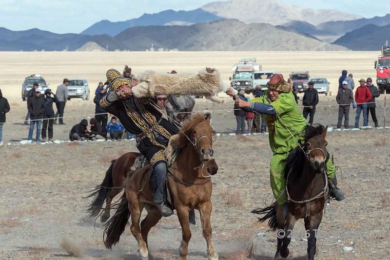 """Winning move<br /> <br /> The Kukhbar competition is one of the highlights of the Eagle Festival in Olgii, Western Mongolia. Kazakh tribesmen mounted on horses battle heatedly to see which one can capture a goat skin from the other while staying on his horse. After several rounds of competition a winner is declared. The horses are as important as the men in the competition as they assist the men in getting good positioning. The referee is right behind them keep a sharp eye on the competitors.<br /> <br /> Other photos from the Kukhbar competition can be seen here: <a href=""""http://goo.gl/4wklTL"""">http://goo.gl/4wklTL</a><br /> <br /> 15/08/15  <a href=""""http://www.allenfotowild.com"""">http://www.allenfotowild.com</a>"""