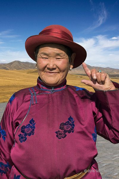 """Portrait of a Mongolian matron in her Sunday best, Genghis Khan monument, Tsonjin Boldog, Mongolia<br /> <br /> Other photos from the area can be seen here: <a href=""""http://goo.gl/D3RUus"""">http://goo.gl/D3RUus</a><br /> <br /> 12/02/15  <a href=""""http://www.allenfotowild.com"""">http://www.allenfotowild.com</a>"""