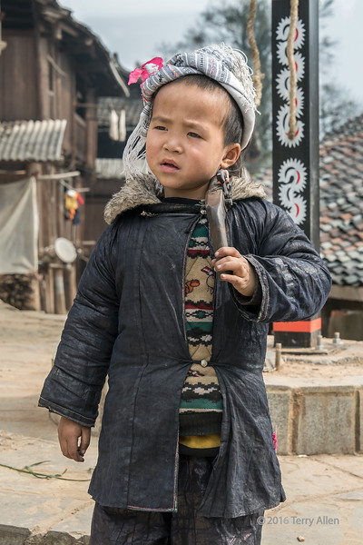 """Boy and his gun<br /> <br /> Young Miao boy in traditional attire with his ancient flintlock pistol, Basha Miao Gun Village, Guizhou Province, China<br /> <br /> Pictures of woman weaving the traditional cotton cloth to make their indigo dyed outfits can be seen here: <a href=""""http://goo.gl/uzkUyY"""">http://goo.gl/uzkUyY</a><br /> <br /> 21/05/15  <a href=""""http://www.allenfotowild.com"""">http://www.allenfotowild.com</a>"""