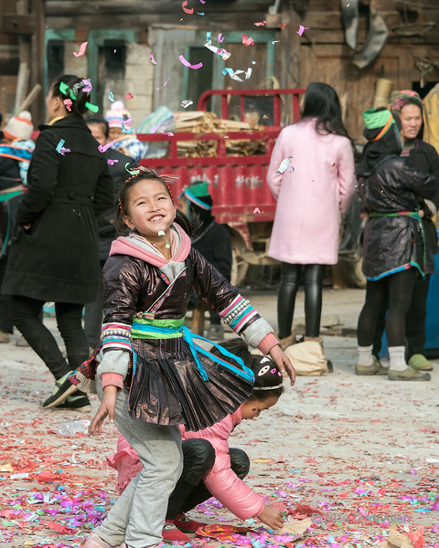 """Ebullient exuberant girls: the joys of youth (best larger) <br /> <br /> Forgot it was alphabet day :-)  Cheerful and full of energy; full of energy, excitement, and cheerfulness<br /> <br /> Dong girls in traditional and western attire playing with the remnants of firecrackers and paper streamers and throwing them up into the air, Huanggang Dong Village, Guizhou Province, China<br /> <br /> More pictures from the festivites can be seen here: <a href=""""http://goo.gl/VzpDpd"""">http://goo.gl/VzpDpd</a><br /> <br /> 29/05/15  <a href=""""http://www.allenfotowild.com"""">http://www.allenfotowild.com</a>"""