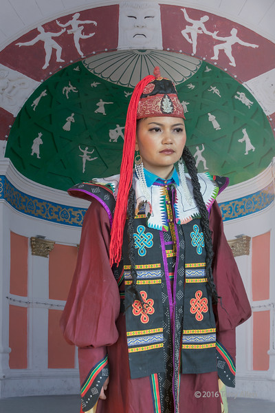 """Woman in traditional attire, Khovd, Western Mongolia<br /> <br /> Khovd is a town in Western Monglia at the foot of the Mongol Altay mountains that is on the northern branch of the ancient silk-road. In the background is the Kovhd <br /> theatre, a neo classical structure built by the  Russians.  Several ethnic minorities live in the Khovd area.<br /> <br /> Other photos from around Khovd can be seen here: <a href=""""http://goo.gl/HPUkkg"""">http://goo.gl/HPUkkg</a><br /> <br /> 19/08/15  <a href=""""http://www.allenfotowild.com"""">http://www.allenfotowild.com</a>"""