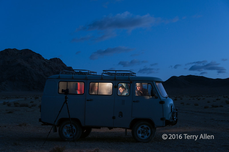 """Early morning coffee<br /> <br /> Before sunrise one cold morning we went out from Khovd, Western Mongolia to shoot the sunrise coming up over the Monol Altay Mountains. I was setting up my tripod and looked over and saw the guys inside the van steaming it up with a fresh pot of coffee.  One of them had left their camera set up on it's tripod outside the van.<br /> <br /> 13/08/15  <a href=""""http://www.allenfotowild.com"""">http://www.allenfotowild.com</a>"""
