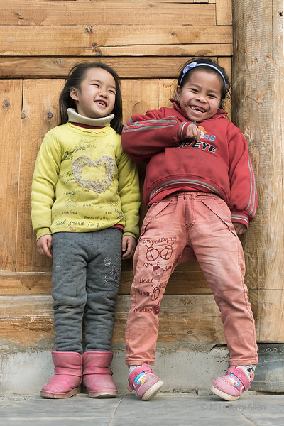 "Gap-toothed smile <br /> <br /> Young girls, Zhaoxing Dong village, Guizhou Province, China<br /> <br /> Saw that SmugMug was back on line, so thought I would post this from the airport.  <br /> <br /> Please vote for my photo of the woman in the Mongolian queen attire, which is one of National Geographic's Daily Dozen for today. <a href=""http://yourshot.nationalgeographic.com/daily-dozen/"">http://yourshot.nationalgeographic.com/daily-dozen/</a>"
