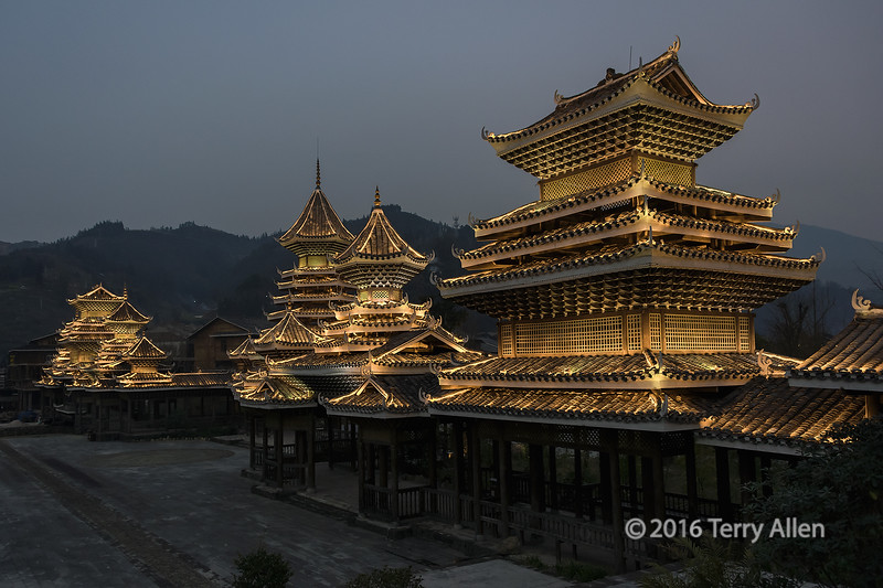 """Entry gate at dusk<br /> <br /> The beautiful architecture of the entry gate to Zhaoxing Dong village was lit up after dark, which showed the structures off to maximum advantage.<br /> <br /> Other photos from the Dong village can be seen here: <a href=""""http://goo.gl/8mlq6T"""">http://goo.gl/8mlq6T</a><br /> <br /> 7/04/15  <a href=""""http://www.allenfotowild.com"""">http://www.allenfotowild.com</a>"""