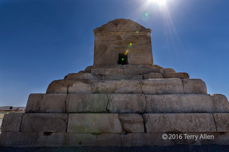 """Tomb of Cyrus the Great with sun flare, Pasargadae, Iran<br /> <br /> I noticed when I positioned the sun at the top of the frame with my wide angle lens that I could see the sun flare in the view finder and could position it in the frame.  In this image, I positioned it leading into the door of the tomb.<br /> <br /> Photos of the palace complex of Cyrus the Great can be seen here: <a href=""""http://goo.gl/9rrVik"""">http://goo.gl/9rrVik</a><br /> <br /> 22/07/15  <a href=""""http://www.allenfotowild.com"""">http://www.allenfotowild.com</a>"""