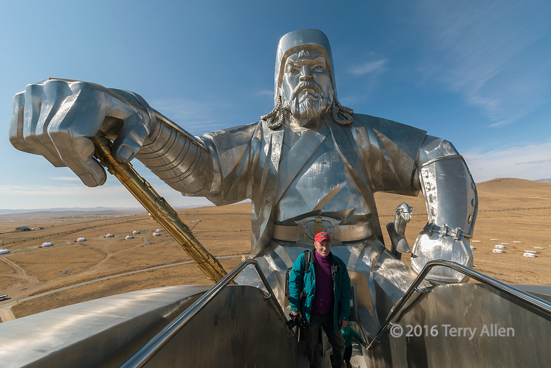 """Giant equestrian statue of Genghis Khan<br /> <br /> This giant steel statue of Genghis Khan (Chinngis Khaan) is built on the steppes near Ulaan Baatar.  It is 40 meters tall and dominates the horizon above the Tuul River.  It was erected at the site where legend has it Genghis Khan, at the age of 15, found a golden whip that inspired him to go on and conquer much of the known world, which after his death became the largest contiguous empire in history. Taken with an ultra wide lens (12 mm).<br /> <br /> Other photos from around the monument, including the whole statue, the trained raptors and the bronze mounted warrior statues, can be seen here: <a href=""""http://goo.gl/QK1CR8"""">http://goo.gl/QK1CR8</a><br /> <br /> 11/02/15  <a href=""""http://www.allenfotowild.com"""">http://www.allenfotowild.com</a>"""