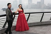 "Wedding couple on The Bund<br /> <br /> It is very traditional for Chinese couples to go to The Bund for their wedding photos, with the Huangpu River and the Pudong skyline in the background.  The Bund is a promenade along the Huangpu river, in the area of the former historic foreign concessions in Shanghai, across the river from the famous Pudong skyline. Chinese couples often have two weddings, a traditional Chinese wedding where the bride wears red, and a western style wedding where the bride wears white. <br /> <br /> Other wedding photos, the Pudong skyline in the fog, and boat traffic on the Huangpu River can be seen here: <a href=""http://goo.gl/zjW21Y"">http://goo.gl/zjW21Y</a><br /> <br /> 09/02/15  <a href=""http://www.allenfotowild.com"">http://www.allenfotowild.com</a>"