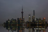 "Night lights (best largest)<br /> <br /> There is a lot going on in this photo of the Pudong skyline in the late evening.  <br /> <br /> First, the story of why so few buildings are lit up....at New Year's there was a number of deaths when the crowds panicked in the crowded viewing stands while viewing the fireworks over Pudong, so the famous lights of Pudong were turned off in mourning.  <br /> <br /> Second, this was a very long exposure (30 sec) made possible by setting the ISO as its lowest value (64), setting the aperture at a very high value (f22) and using a 6 stop neutral density filter to hold back the light so the river would go smooth.<br /> <br /> Third, a freighter went through the scene as the shutter was open, so the streaks of light are from its mast head running light (yellow streak) and the starboard running light (green).<br /> <br /> Fourth, the extremely tall building in the background is the Shanghai tower, the 2nd tallest building in the world.  They now have the lower two-thirds of the building finished and lit up inside and it will be completed soon, according to one of the building architects I talked to on the flight over.<br /> <br /> Fifth, I used a flood filter to put reflections of the skyline in the smooth water to add a little pizzaz since the skyline was darker than usual and didn't reflect well.<br /> <br /> A couple more shots from Shanghai can be seen here: <a href=""http://goo.gl/aIqHP9"">http://goo.gl/aIqHP9</a><br /> <br /> 17/02/15  <a href=""http://www.allenfotowild.com"">http://www.allenfotowild.com</a>"