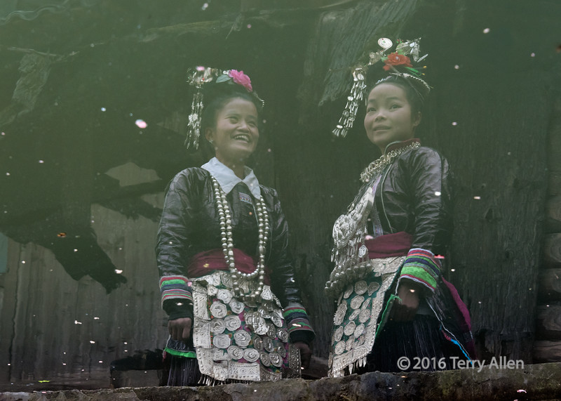 """Reflections<br /> <br /> Reflections of two village beauties in traditional attire in the local (rather dirty) pool, Huanggang Dong Village, Guizhou Province, China.  This is another one of my attempts to try to achieve a different in camera effect.<br /> <br /> Other photos from the village can be seen here: <a href=""""http://goo.gl/tEz9T1"""">http://goo.gl/tEz9T1</a><br /> <br /> 12/07/15  <a href=""""http://www.allenfotowild.com"""">http://www.allenfotowild.com</a>"""