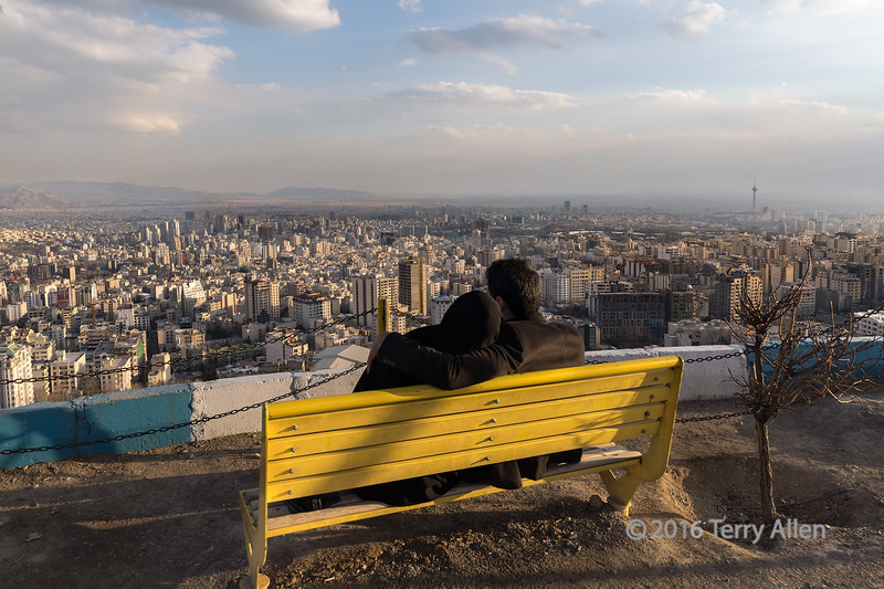 "A quiet moment<br /> <br /> An anonymous couple enjoys the sunset view of Tehran from Tochal Mountain, Iran.  The Miladi tower can be seen to the far right in the middle of the image.<br /> <br /> Other views of Tehran can be seen here: <a href=""http://goo.gl/h7TM36"">http://goo.gl/h7TM36</a><br /> <br /> 16/04/15  <a href=""http://www.allenfotowild.com"">http://www.allenfotowild.com</a>"