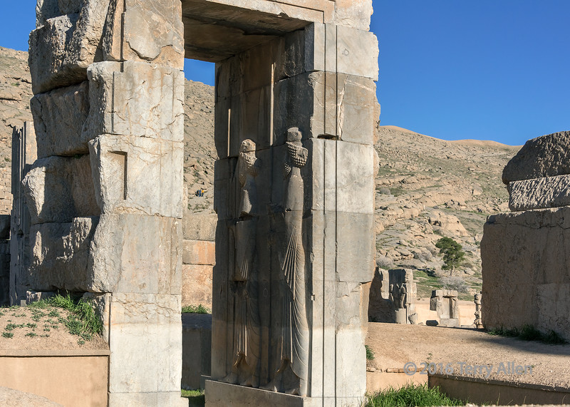When Alexander the Great captured Persepolis in 330 BC his troops sacked the ancient site and destroyed much of it.  Some of the massive doorways surveyed the destruction.  This doorway leading into The Throne Hall (Hall of 100 Columns) still has some well preserved bas relief figures caved into the interior of the doorway.