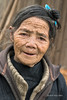 "Portrait of a Basha Miao female elder <br /> <br /> Basha village, Guizhou Province, China. Note the traditional topknot in her hair.  This lovely old lady gave me a very sweet smile as I took her photo.<br /> <br /> Other images of the ethnic Miao people can be seen here: <a href=""http://goo.gl/X379zl"">http://goo.gl/X379zl</a><br /> <br /> 25/04/15  <a href=""http://www.allenfotowild.com"">http://www.allenfotowild.com</a>"
