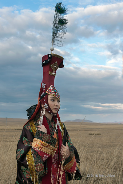 """Mongolian queen<br /> <br /> Portrait of a woman in a Mongolian queen's traditional attire on the steppes, east of Ulaan Baatar.<br /> <br /> The series of shots I did of this beautiful model can be seen here: <a href=""""http://goo.gl/4QaD0S"""">http://goo.gl/4QaD0S</a><br /> <br /> 18/02/15  <a href=""""http://www.allenfotowild.com"""">http://www.allenfotowild.com</a>"""