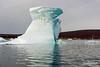 Iceberg with schooner
