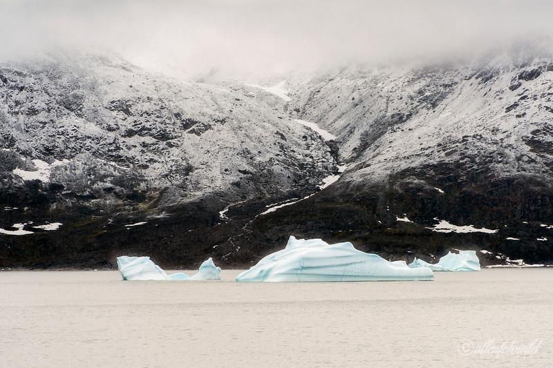 Geikie Plateau with blue iceberg