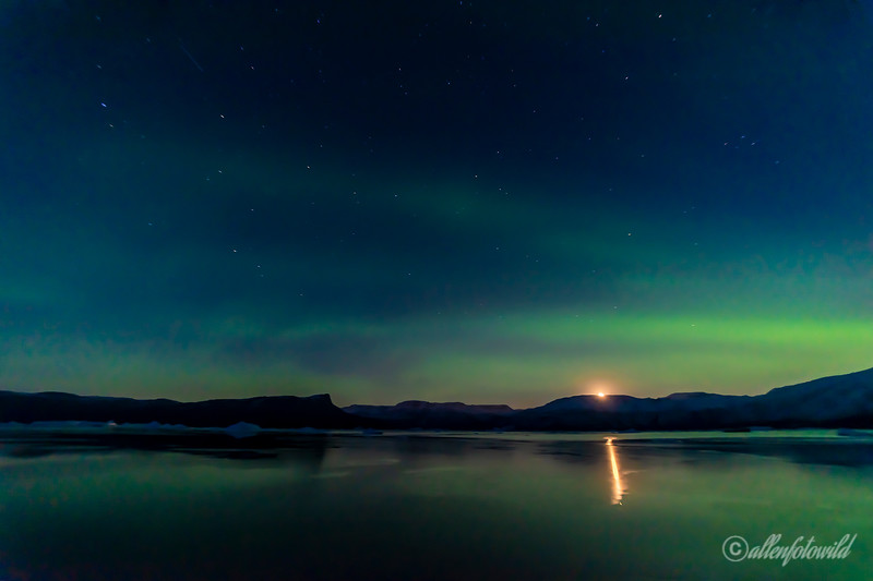 Moonrise with northern lights
