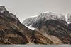 Small receeding glacier and glacial scree on Stor Island, Ofjord, Scoresby Sund, Greenland